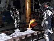 molten bronze being poured into silica molds